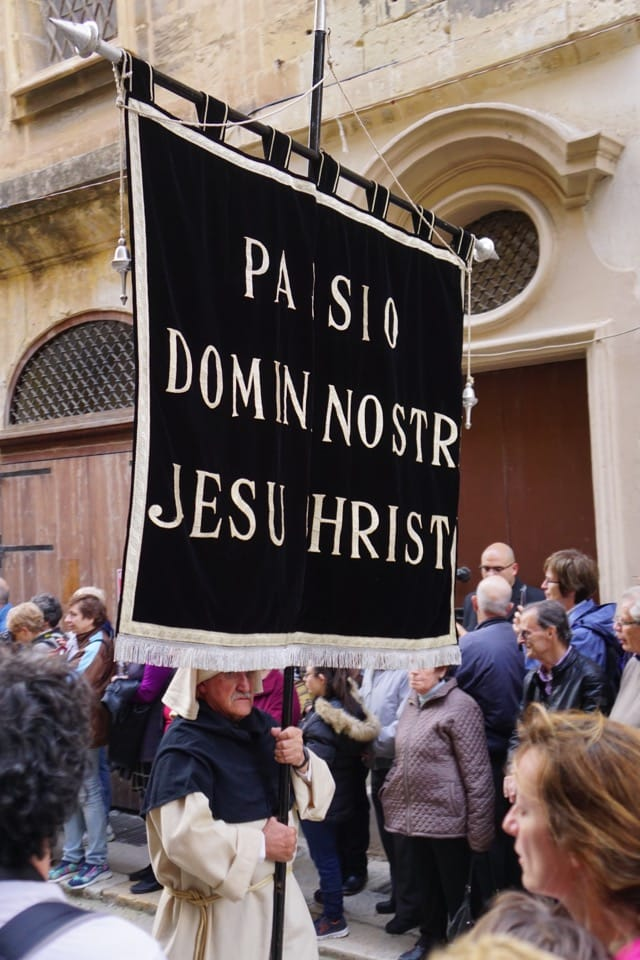 People carrying sign during Good Friday Procession