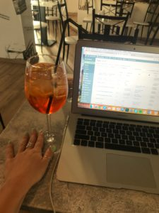 Aperol and laptop at fellini cafe